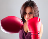 Sexy girl woman athlet in red boxing gloves kicking Stock Images
