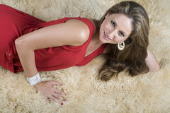 Sexy Girl on Wool Rug Stock Images