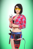 Sexy girl with wrench Royalty Free Stock Photos