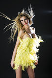 Sexy girl in yellow dress with wind in her hair Royalty Free Stock Photos
