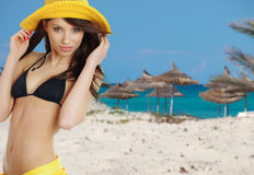Sexy girl in yellow hat and bikini Royalty Free Stock Images