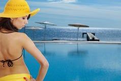 Sexy girl in yellow hat and bikini Stock Photo