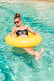 Sexy girl with yellow ring at pool party Stock Photo