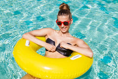 Sexy girl with yellow ring at pool party Stock Image