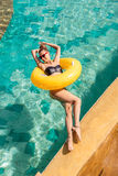 Sexy girl with yellow ring at pool party Stock Photography