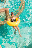 Sexy girl with yellow ring at pool party Stock Images