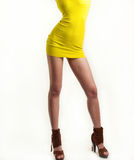 Girl in yellow short dress isolated on white background, studio shot. Attractive model in fashion concept royalty free stock images