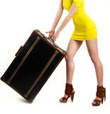 Sexy girl in yellow short dress with suitcase Stock Photo