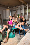 Sexy girls in the carpentry shop carpenters Stock Images