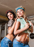 Sexy girls in the carpentry shop carpenters Royalty Free Stock Image