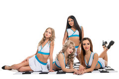 Sexy girls in formula one clothes sitting on flag Royalty Free Stock Photo