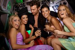 Sexy girls having fun in limo. Usine with handsome men at bachelorette party Royalty Free Stock Photos