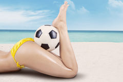 girls legs with ball Stock Images