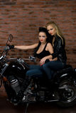 Sexy girls on motorbike Royalty Free Stock Photo