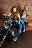 Sexy girls on motorbike Stock Images