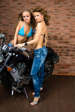 Sexy girls on motorbike Royalty Free Stock Image