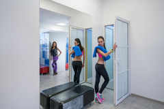 Sexy girls posing in locker room of fitness center Stock Images
