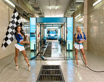 Sexy girls posing at vehicle maintenance station Royalty Free Stock Photos
