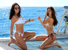 Sexy girls sailing in bikini sisters mother daughter mom girl at Los Cabos Mexico. Playboy girls Stock Photos
