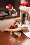 Sexy girls in Santa hats waiting for New Year Stock Images