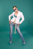 Sexy girls wearing glasses, jeans, a white jacket Stock Images