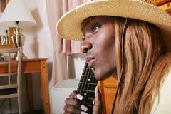 Sexy gitaarspeler stock foto