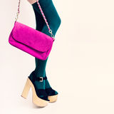 Sexy glamorous lady in green stockings on white background. Pink. Clutch. Fashion accessories Stock Photos