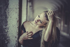 Sexy Glamour Blonde angel, young woman with black wings, autumn Royalty Free Stock Images