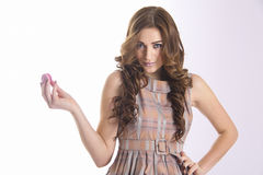 Sexy glamour brown haired woman with sweet macaron Royalty Free Stock Photography