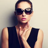 Sexy glamour female model in trendy sun glasses with hand at fac. E. Closeup vintage portrait Royalty Free Stock Photos