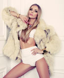 Sexy glamour girl with blond hair in fur coat Royalty Free Stock Image