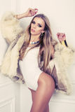 Sexy glamour girl with blond hair in fur coat Stock Photo
