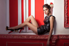 Sexy glamour girl in red vintage room. Professional make up and hairstyle Royalty Free Stock Photo