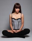 Sexy glamour model girl cross legged in lingerie Stock Photo