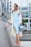 Sexy glamour woman in blue fashion style dress with handbag Stock Image