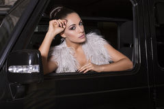 Sexy glamour woman driver sittin in the car Stock Photos