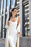 Sexy glamour woman wear white fashion style dress bag Stock Photo