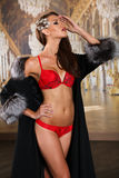 Sexy glamour young woman in red fashionable lingerie and luxury fur coat Stock Photos