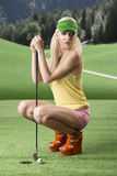 Sexy golf player woman folded down Stock Photos