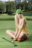 Sexy golf player woman with golf club Royalty Free Stock Photography