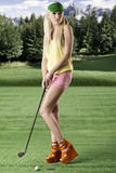 golf player woman, she looks at left Stock Photos