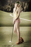 Sexy golf player woman, she looks in to the lens Royalty Free Stock Photos
