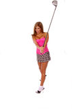 Sexy Golfer. Sexy latino golfer in a plaid skirt and pink corset. swinging a driver Royalty Free Stock Photography