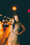 Sexy gorgeous brunette girl portrait in night city lights Stock Photos