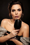 Sexy gorgeous woman with dark hair holding glass with black cavi Stock Photo