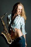 Sexy gorgeous young pretty blonde with sax Stock Photos