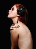 Sexy goth girl with black flower Stock Images