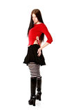 goth girl in red top looking over shoulder Stock Image