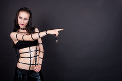 Sexy gothic emo girl pointing Stock Image
