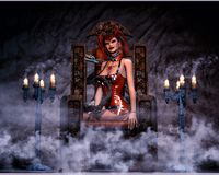 Sexy gothic woman with snake. Gothic woman sitting on a chair with a python snake Royalty Free Stock Photography